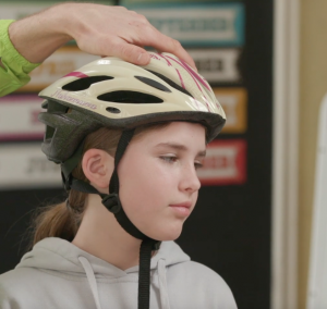 video cover of girl wearing helmet